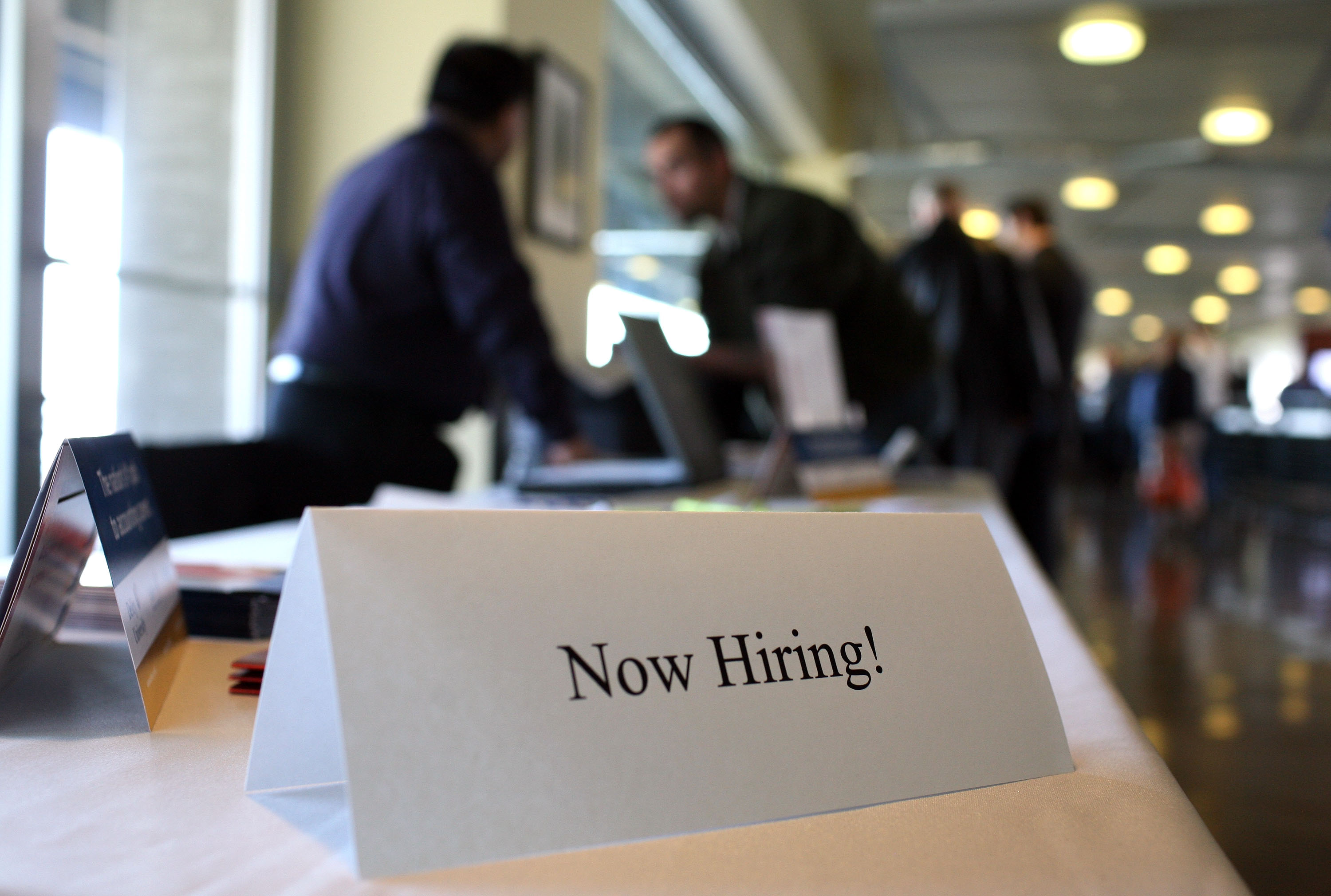 "SAN FRANCISCO - MARCH 19: A ""now hiring"" sign is posted on a table during the Recruit Military Career Fair March 19, 2009 at AT&T Park in San Francisco, California. Hundreds of military veterans attended the career fair that was open only to veterans. (Photo by Justin Sullivan/Getty Images)"