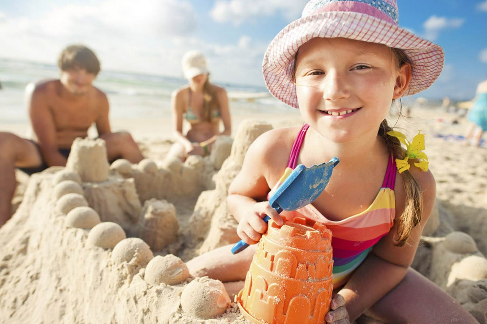 635728667537743721-532730049_a-child-building-a-sand-castle